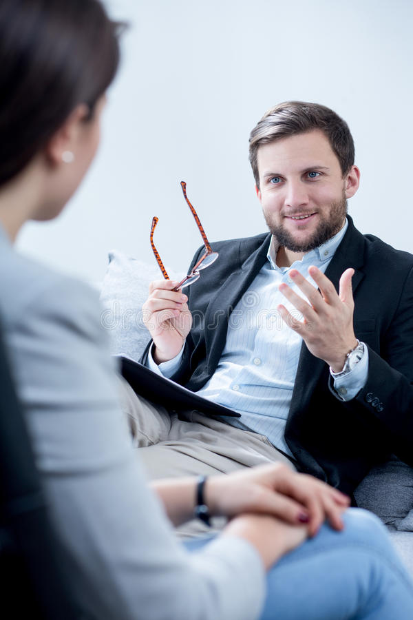 Private professional counselor. Image of private professional counselor during session royalty free stock photo