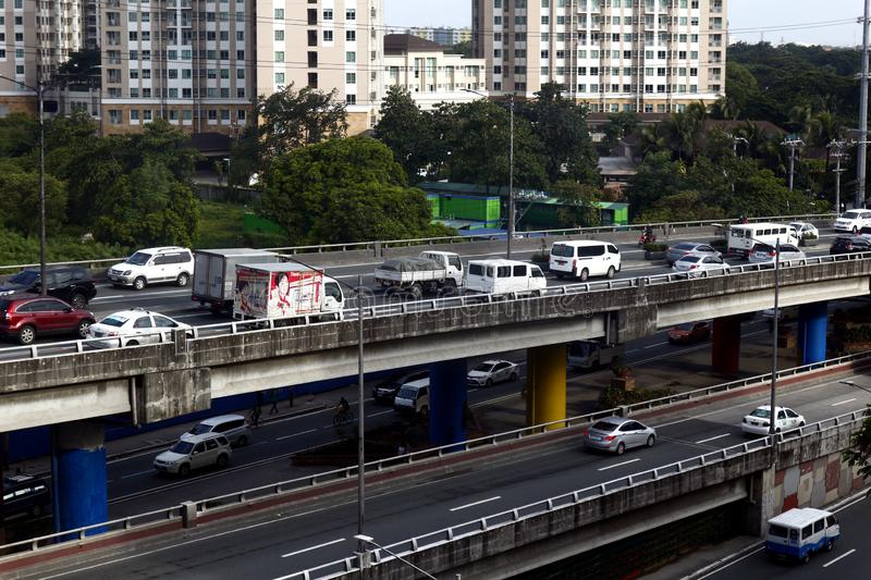 Private and public vehicle pass along flyovers or bridges stock photos