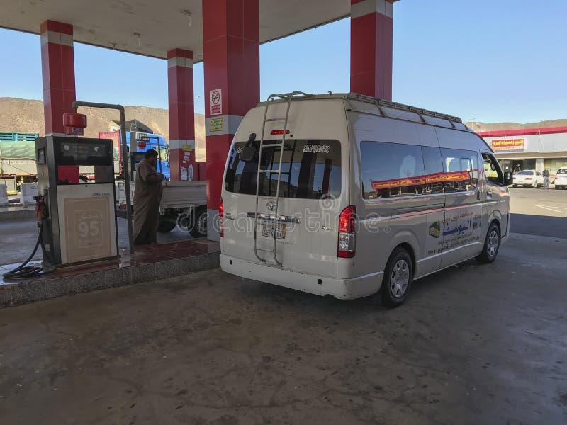 Private and public vehicles llne up to fill up gas at Al Khaleej petrol station at Makkah-Medinah highway, Saudi Arabia. royalty free stock photo
