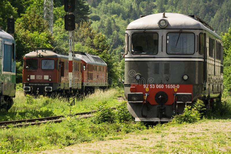 Romanian private railway operator diesel locomotives shunting. Private railway operator DB Schenker Rail and Heidelberg Cement locomotives are shunting in Bicaz royalty free stock photos