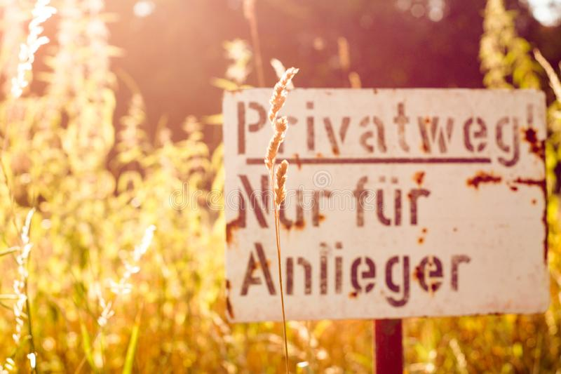 Private Residents Only Sign. German sign that reads: Private! Residents only. Autumn backdrop and rusting on the sign stock photo