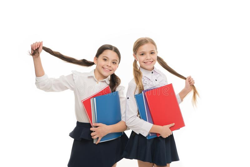 Private school. Girls with school textbooks white background. We love study. Studying is fun. Buy book for extra school stock photos