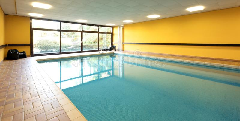 Private swimming pool in a building stock photography