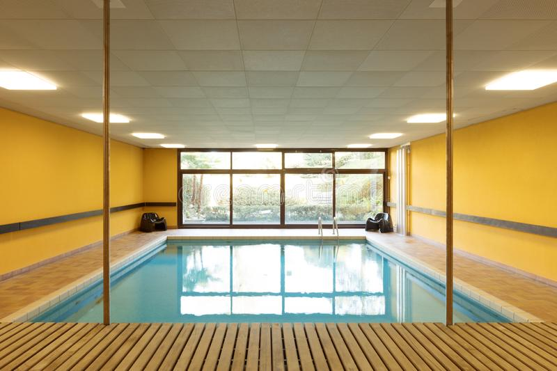 Private swimming pool in a building stock photo