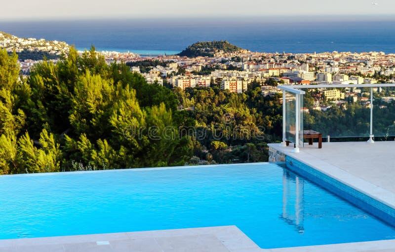 Private swimming pool. Modern villa. royalty free stock photos