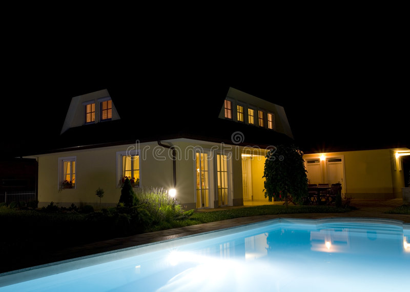 Private swimming pool at night royalty free stock photos