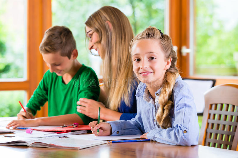Private teacher giving lessons at home stock photography