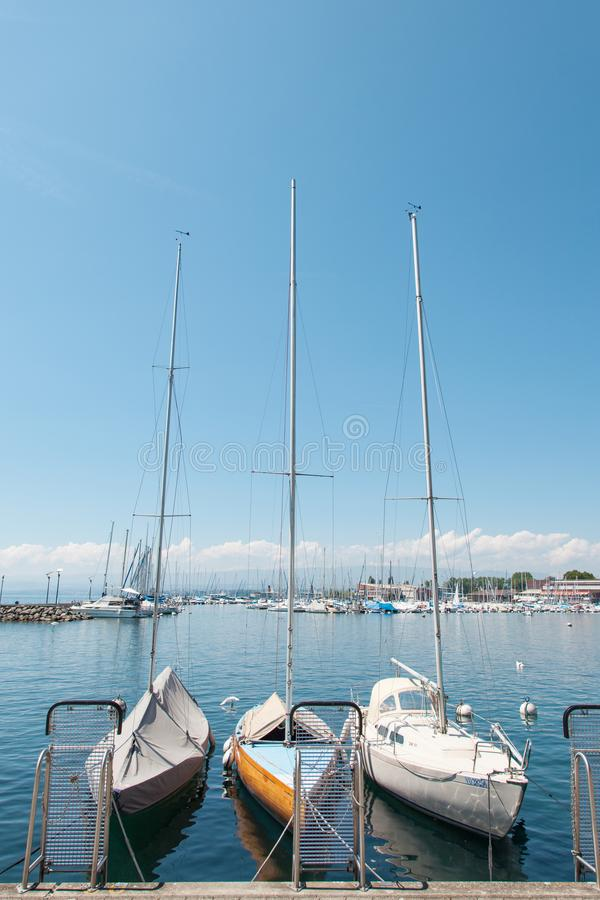 Private yachts docked in Lausanne Ouchy port, Switzerland on Lake Leman, Geneva Lake royalty free stock image