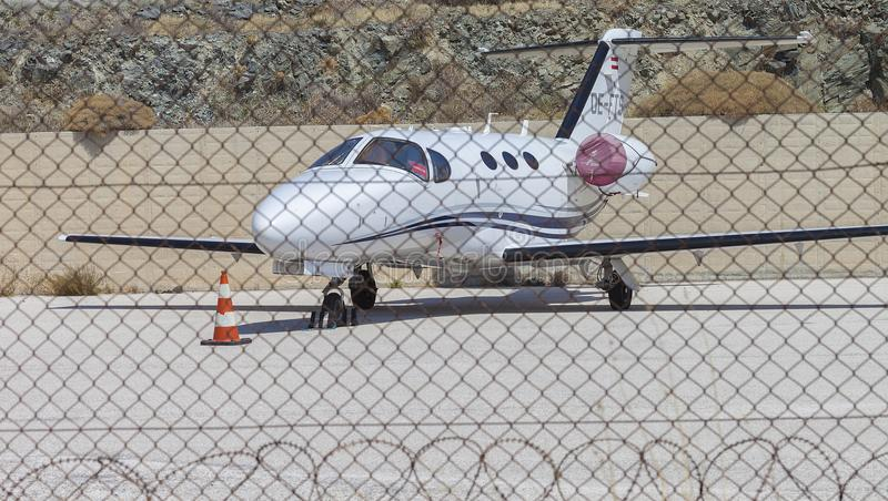 Prive Small Jet Plane Parked Behind Protected Barbed Wire . Editor royalty free stock photos