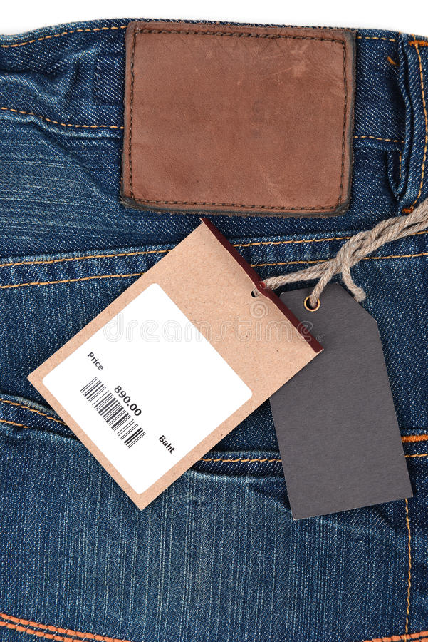 Prix à payer avec code barres sur des jeans images stock
