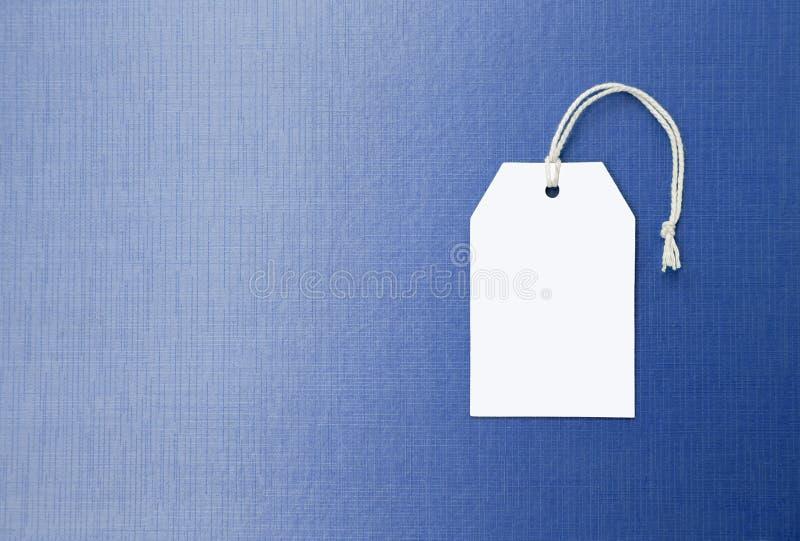 Prix à payer de livre blanc sur le fond bleu de texture, fond de concept d'affaires photos libres de droits