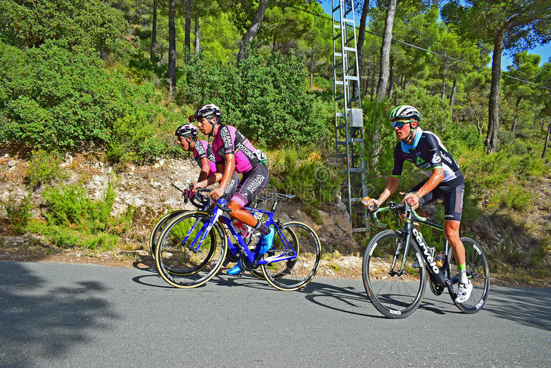 Pro Cyclists La Vuelta. The riders near to the mountain summit on stage eight Xorret De Cati in the 2017 La Vuelta España bike tour royalty free stock images
