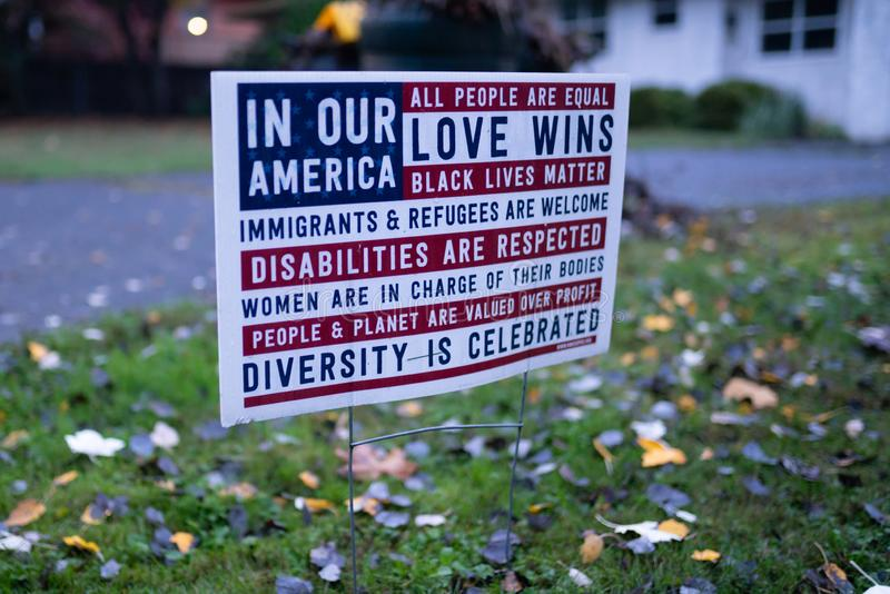 Pro democratic poster on the lawn. Portland, OR / USA - October 31 2018: Pro democratic poster in the lawn of the house, made in a form of an American flag stock image
