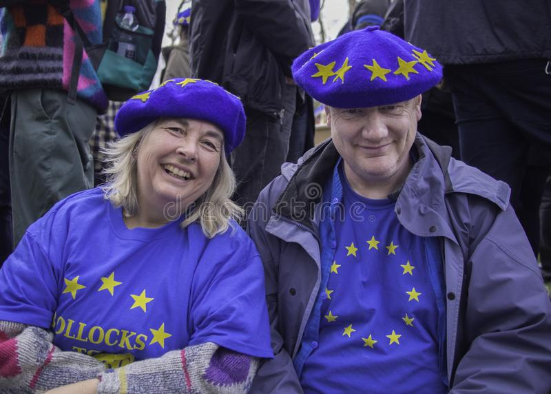 Pro EU couple during anti Brexit demonstration in London, March 2019. Older white couple during anti Brexit protest wearing  pro EU blue t-shirts and hats stock image