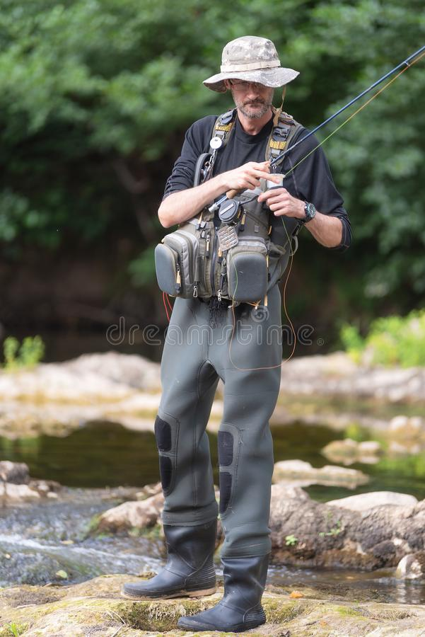Pro fishermen with fishing rod, hobby and sport activity. Pro fishermen with fishing rod, hobby and sport activity stock photography