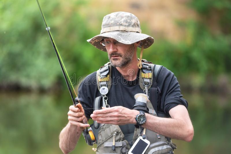 Pro fishermen with fishing rod, hobby and sport activity. Pro fishermen with fishing rod, hobby and sport activity stock image