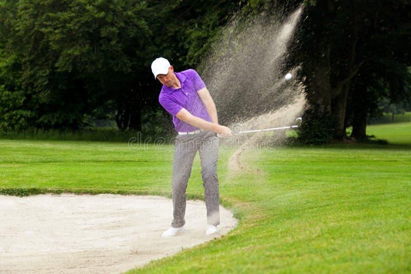 Pro golfer bunker shot stock photos