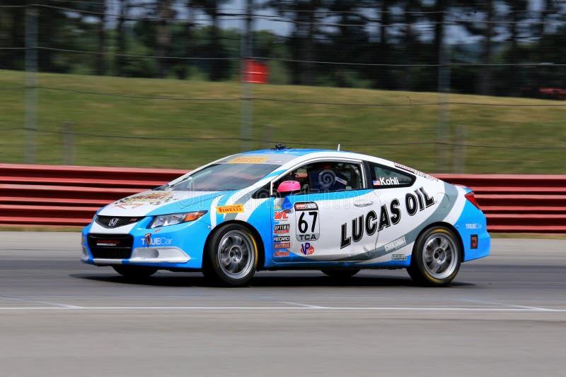 Pro-Honda Civic siracerbil på spåret royaltyfria bilder