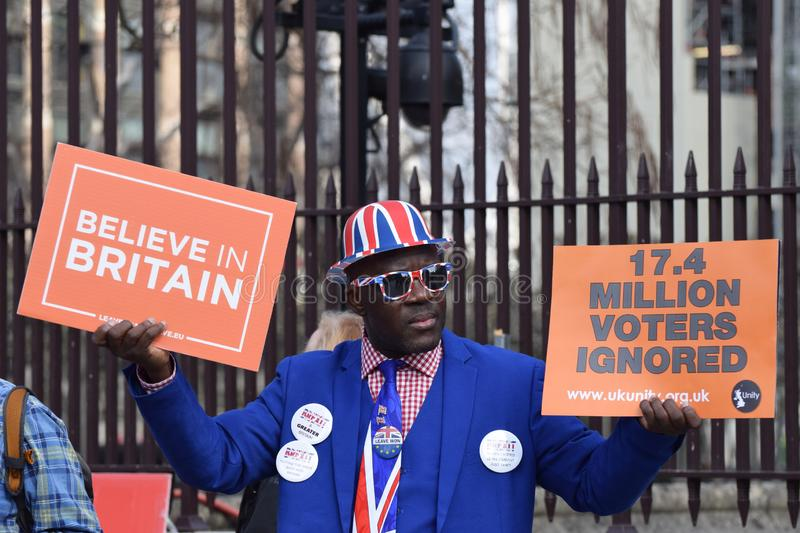 Brexit pro leave, pro no deal protester in Westminster London. March 28 2019. A pro leave, anti EU protester holding signs that read `Believe in Britain` and `17 royalty free stock image