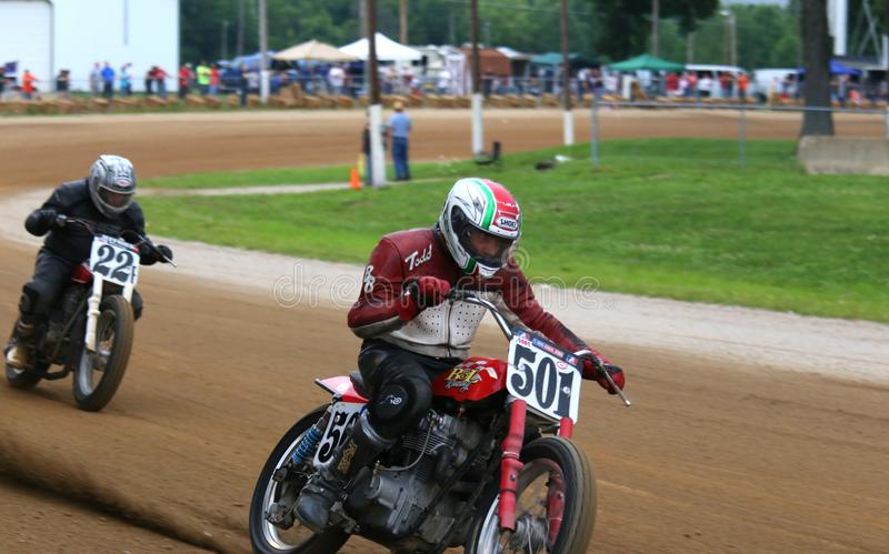 Pro motorcycle racers in action. Dirt motorcycle racers on the race track at the classic motorcycle racing event on the dirt oval flat track speedway, Ashland stock photos