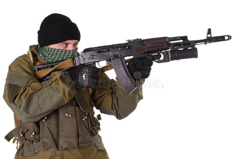 Pro-Russian militiaman with kalashnikov ak-47 rifle with under-barrel grenade launcher. Pro-Russian militan with kalashnikov ak-47 rifle with under-barrel royalty free stock photography