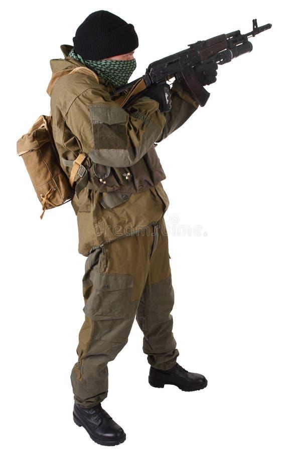 Pro-Russian militiaman with kalashnikov ak-47 rifle with under-barrel grenade launcher. Pro-Russian militan with kalashnikov ak-47 rifle with under-barrel royalty free stock photos