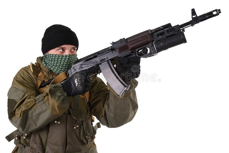 Pro-Russian militiaman with kalashnikov ak-47 rifle with under-barrel grenade launcher. Pro-Russian militan with kalashnikov ak-47 rifle with under-barrel royalty free stock images