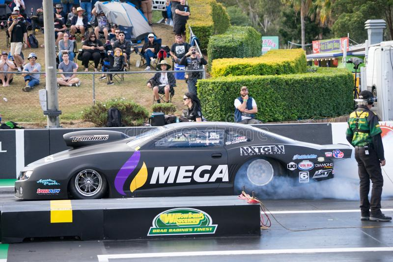 Pro Stock Category 2018 Winternationals Ipswich Australia. A pro stock cardoing burnouts at the starting line during the celebration of the 2018 Gulf western royalty free stock images
