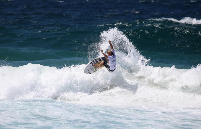 Pro surfer. Chad Du Toit from South Africa sends spray flying with an agressive turn, whist competiting in the 4 star WQS Surfest professional surfing stock photos