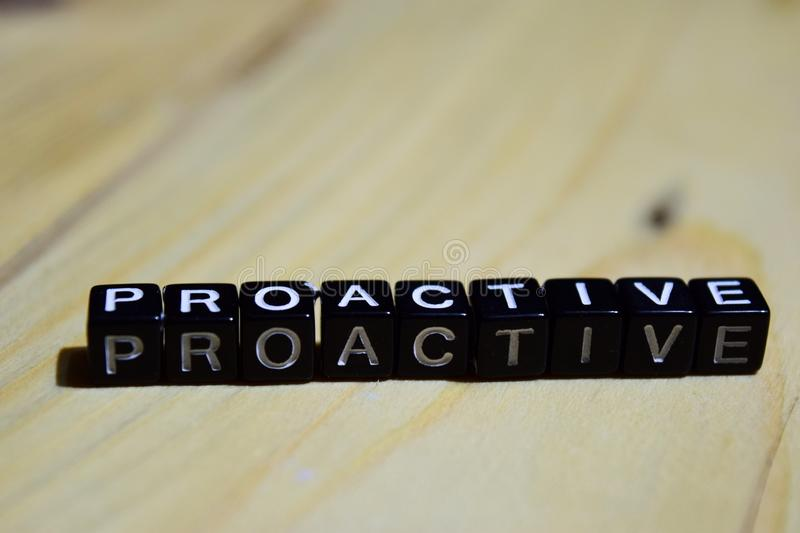 Proacive written on wooden blocks. Inspiration and motivation concepts royalty free stock images