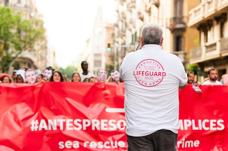 Barcelona, spain- 17 july 2019: proactiva open arms march holding banner in  protest against european immigration policies and in royalty free stock image
