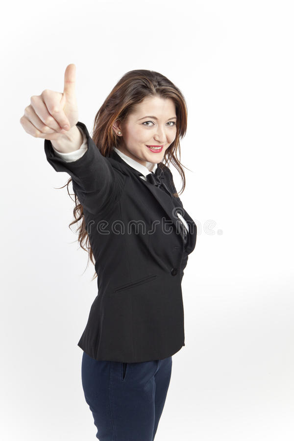 Proactive business woman. Portrait of a proactive, cheerful business woman giving thumbs up sign royalty free stock photos