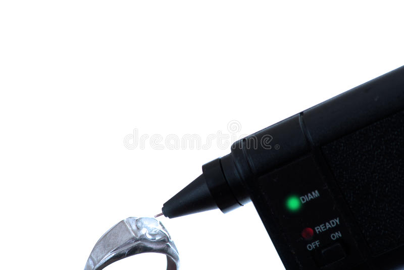 Probador y anillo del diamante imagen de archivo libre de regalías