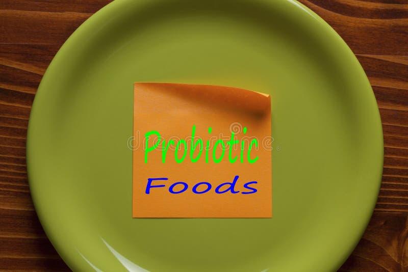 Probiotic Foods som är skriftliga på en anmärkning royaltyfria foton