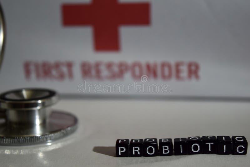 Probiotic meddelande som är skriftligt på träkvarter Stetoskop hälsovårdbegrepp royaltyfri bild