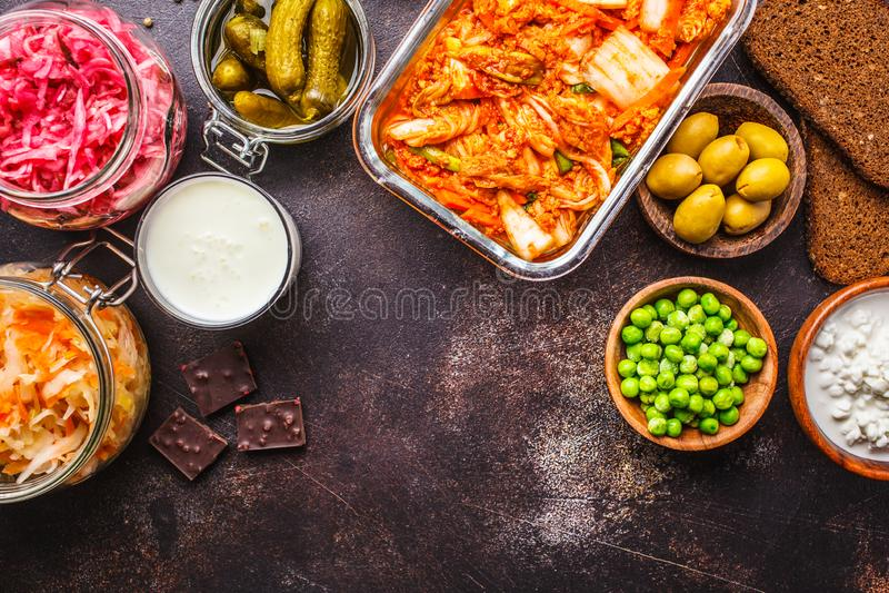 Probiotics food concept. Kimchi, beet sauerkraut, sauerkraut, cottage cheese, peas, olives, bread, chocolate, kefir and pickled royalty free stock photo