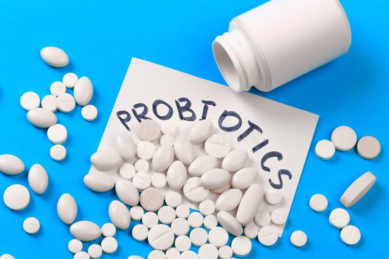 Probiotics white  dragee on blue background  - Image stock images