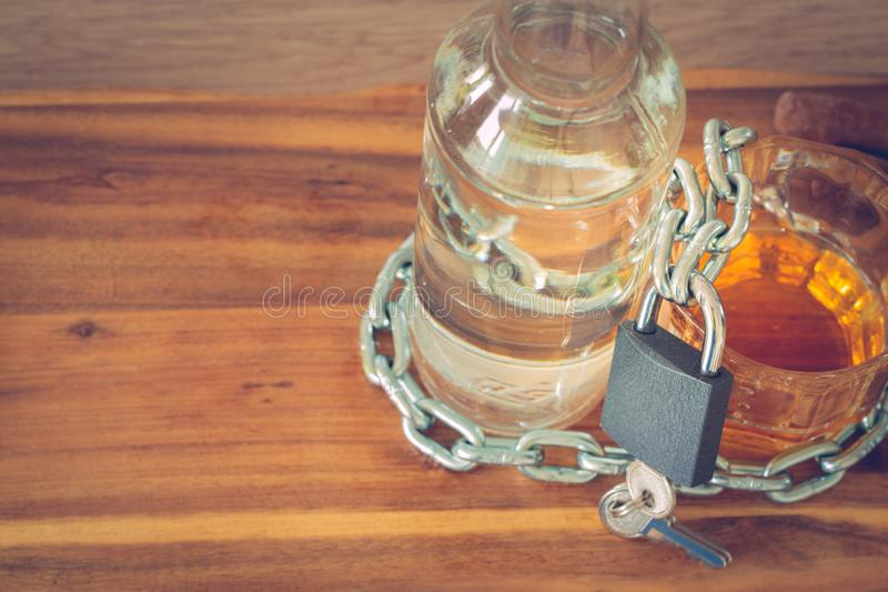 Alcoholic problem. Vodka,wine,whiskey,beer on the table locked with a chain and locked with a padlock, Concept, Place for text. Problem with alcohol, Vodka,wine royalty free stock photos