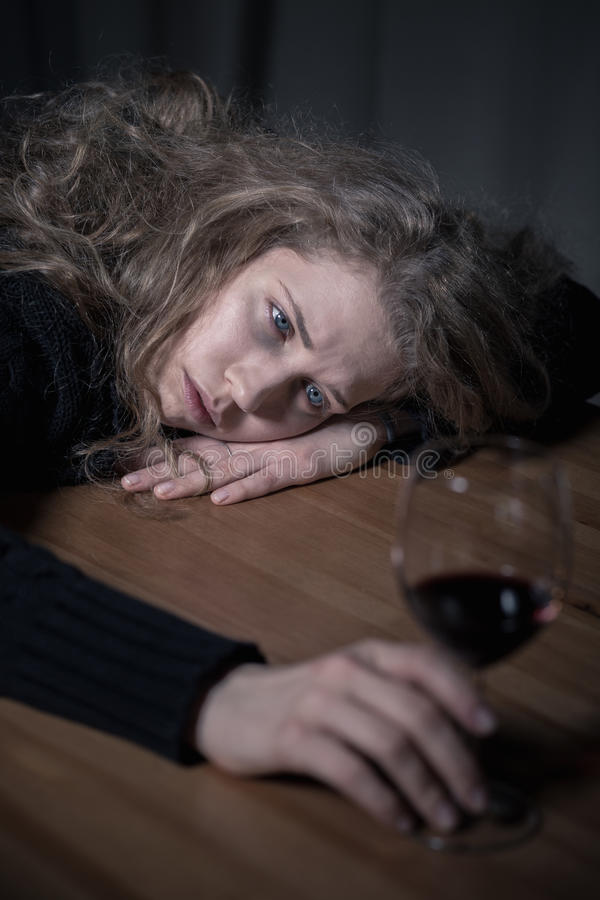 Problem of alcoholism. Picture presenting problem of alcoholism among young adults royalty free stock images
