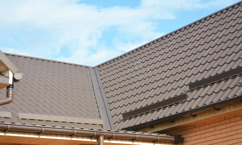 Problem Areas for House Metal Corner Roofing Construction Waterproofing. Rain gutter system and roof protection from snow board stock photos