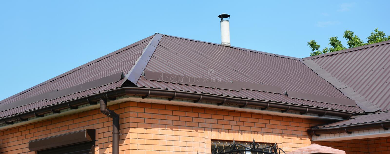 Problem areas for metal roof and rain gutter waterproofing. Guttering, gutters, metal roofing house panorama royalty free stock photo