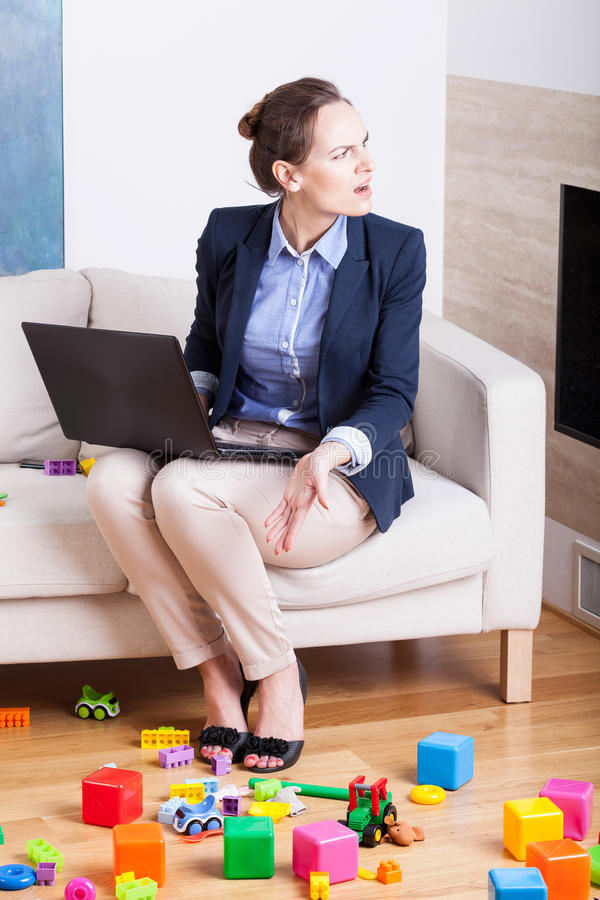 Problem with concentrating on work at room full of kids toys stock photo