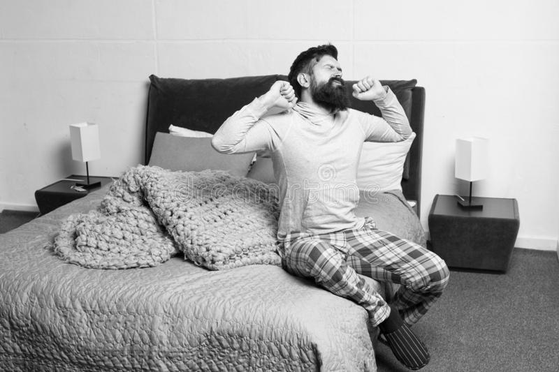 Problem with early morning awakening. Get up early. Tips for waking up early. Man bearded hipster sleepy face pajamas stock photos