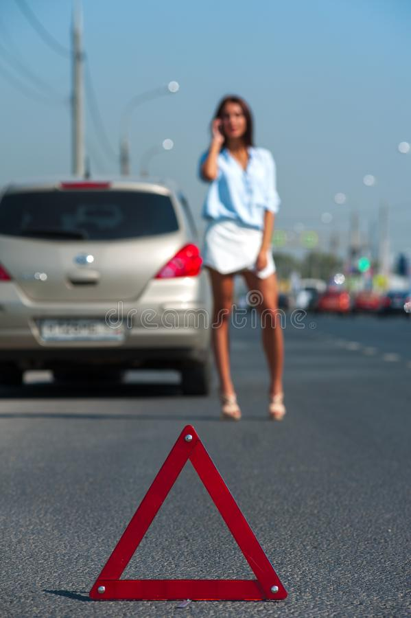 Young charming woman having problem with her car royalty free stock photography