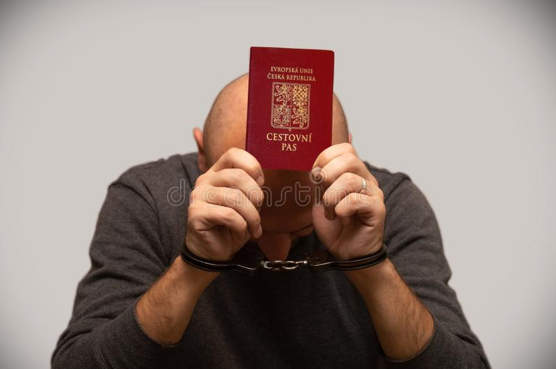The problem of illegal immigration of refugees from the Czech Republic, a Czech immigrant in handcuffs. Illegal border crossing, b. Order trespasser arrested stock photography