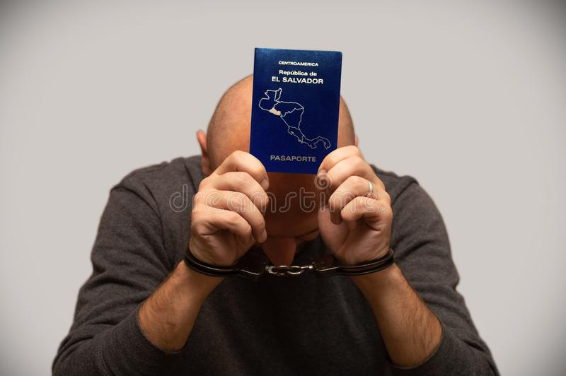 The problem of illegal immigration of refugees from El Salvador, an immigrant from El Salvador in handcuffs. Illegal border crossi. Ng, border trespasser stock images
