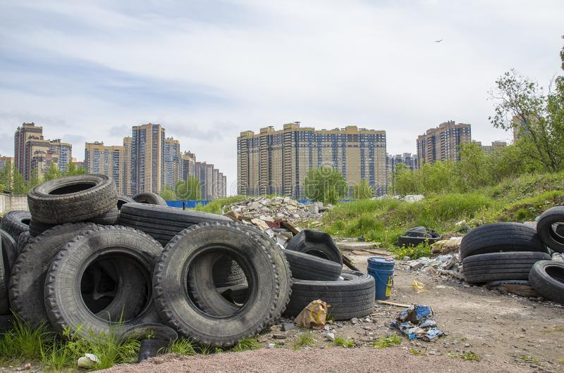 Problem of landfill, the problem of environmental pollution and waste processing in large cities. garbage in residential areas royalty free stock photo