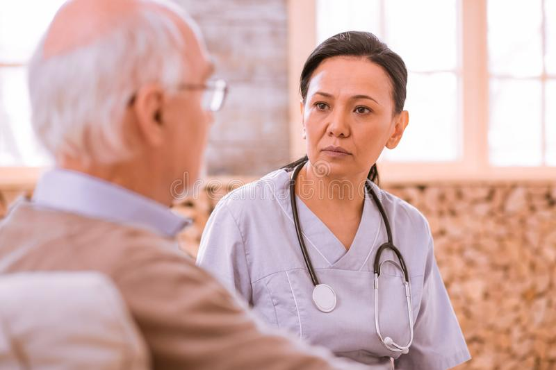 Attentive young woman listening to her patient stock image