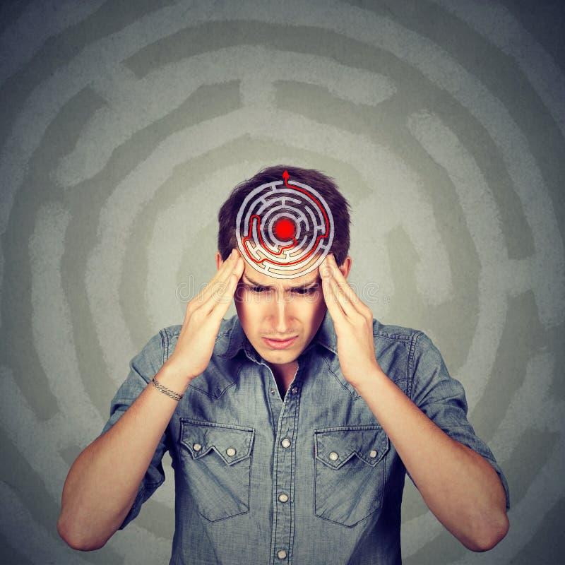 Problem solution concept. Man solving puzzle stock photo