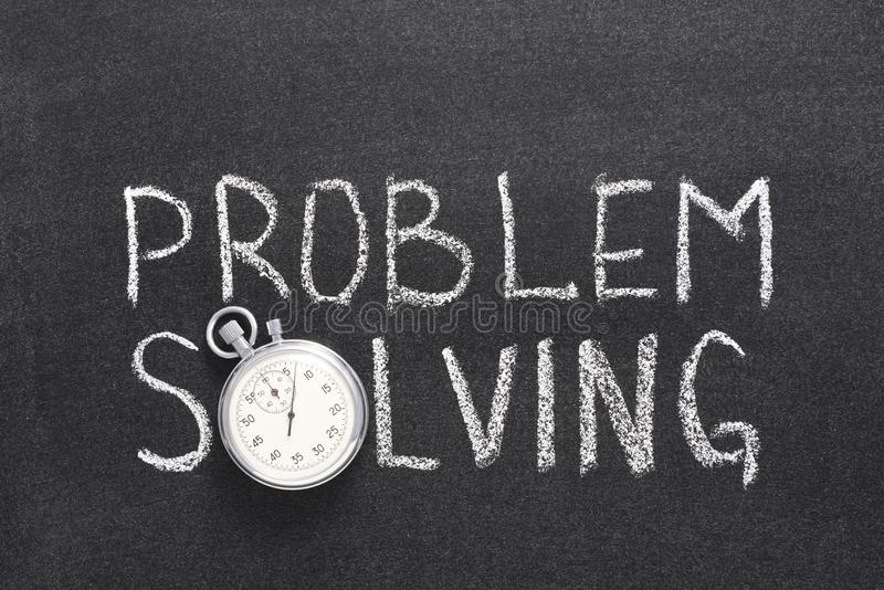 Problem solving watch. Problem solving phrase handwritten on chalkboard with vintage precise stopwatch used instead of O royalty free stock photo